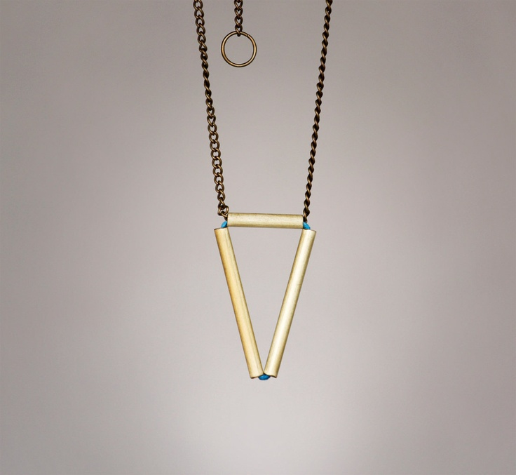 the empty triangle on a chain pendant. $40.00, via Etsy.