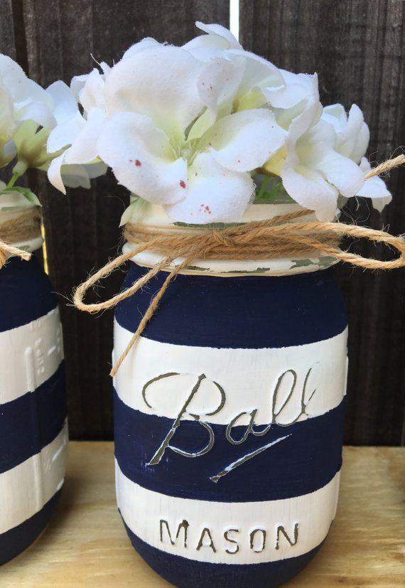 Nautical Mason Jars- Distressed Mason Jars-Nautical Baby Shower-Nautical Home Decor- White and Navy Blue Stripes Mason Jars-Nautical Wedding Decor DISTRESSED MASON JARS Handmade Nautical mason jars, beautiful home decor, wedding centerpieces, baby shower decorations. This set is beautiful addition to any nautical theme event, especially weddings, Wedding rehearsal dinners, baby shower or simply beautiful decor in your home. Mason jars are all hand painted, distressed, tied with twine…