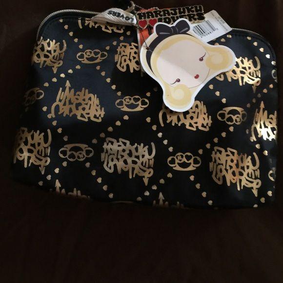 Harajuku  Lovers black and gold make up bag Adorable black with gold writing on …