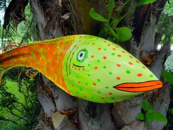 This is a fun colorful Palm Frond fish. Orange swirls and little key lime. Measures about 22. For better description read about my other palm art.