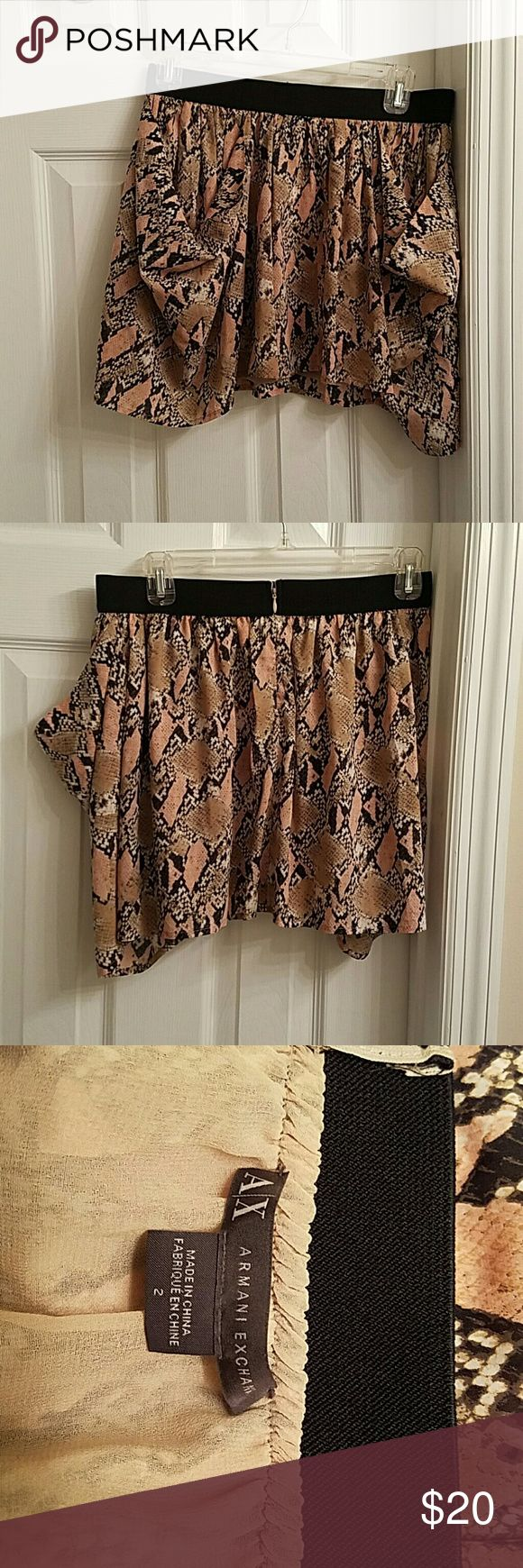 Armani Exchange skirt Armani Exchange skirt in a plush snake skin print in size 2 lightly lined . In great condition Armani Exchange Skirts Midi