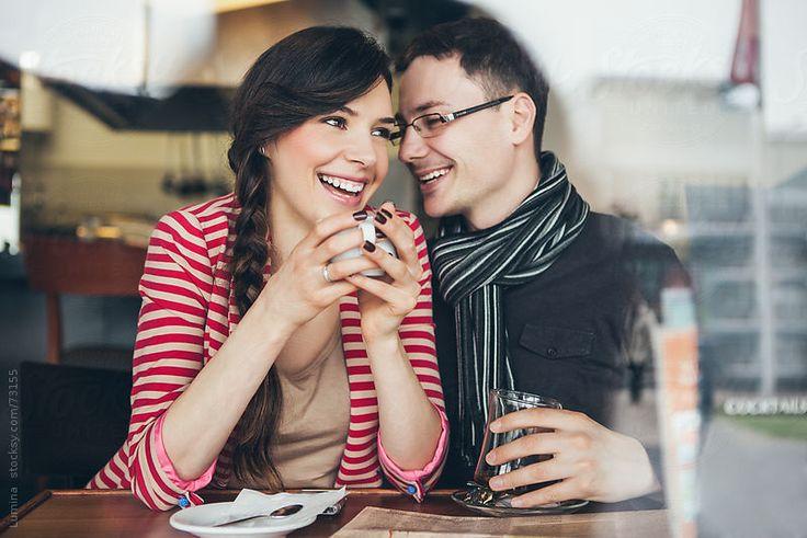 Smiling Couple Enjoying at a Cafe by Lumina