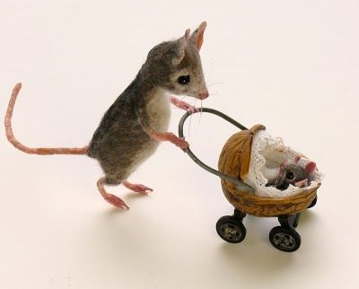Fairy oe Mouse House Baby Carriage ~The pram is made from a walnut shell with a hairpin handle. The wheels are black wooden discs between clothing snaps and eyelets.