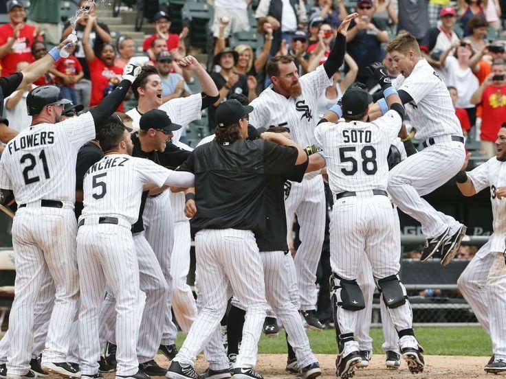 June 21 - White Sox third baseman Gordon Beckham celebrates with teammates after his walk-off home run Rangers. - © Kamil Krzaczynski, USA TODAY Sports