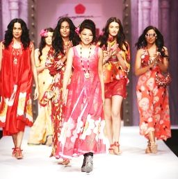 The Day-1 of the Wills Lifestyle India Fashion Week (WIFW) concluded on Wednesday with cool resort wear and a range for women who love to travel, which started today with autumn collection of Anupam Dayal and Masaba Gupta.  Fashion designer Malini Ramani's spring-summer collection had a lot of applique work. She made use of metallic belts with some of the free flowing dresses. There were also shorts, one-piece swimwear and long skirts in mostly shades of brown and black.