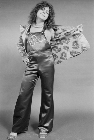 Marc Bolan showing off the lining of his custom jacket, which features the EMI T.Rex label logo, c.1972