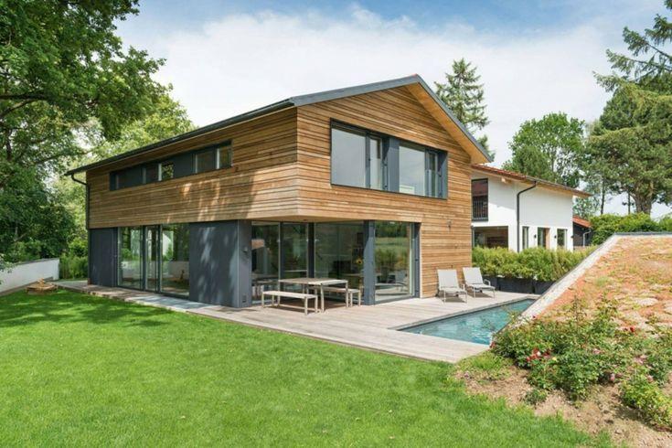 interior de madeira e concreto pátio design cinza chaise longe   – Alpenländische Architektur