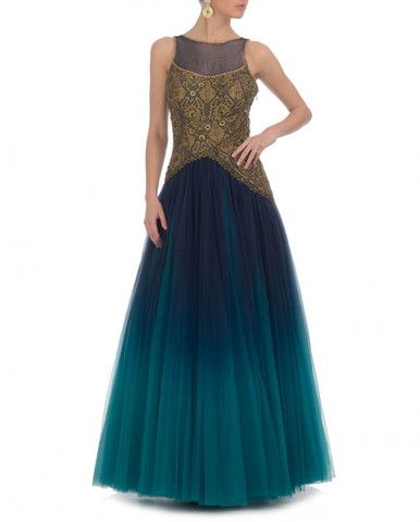 This aqua blue shaded Indo-Western gown is in pure net. Yoke of this gown is embellished with zari and tilla work. Back of this Indo-Western gown is also designed with net fabric. This gown is availab