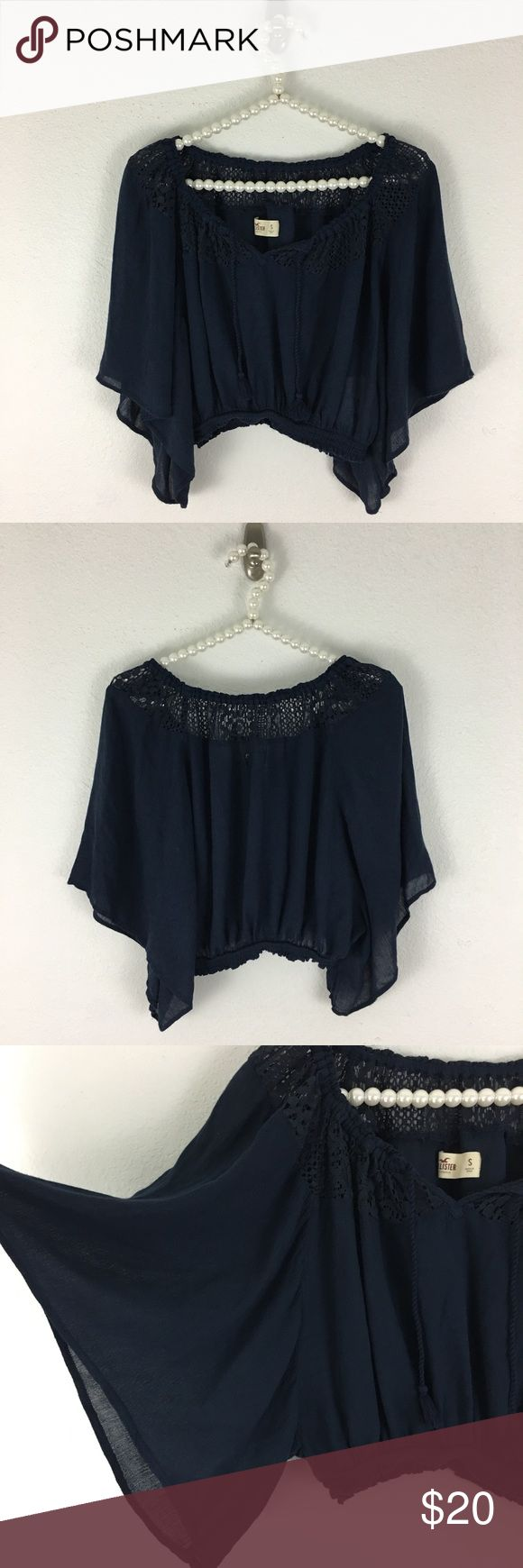 Hollister 🌻Festival🌻 Crop Top ! So cute ! Sz Sm I love this shirt ,the sleeves and neckline are flattering - it has elastic around the neckline and it can be worn on or off the shoulder depending on your style. Navy Blue, Kimono style sleeves & elastic hem. It's gauze material & made of 100% Rayon. This is a size Small with a loose open bust - I measured the elastic waist and that is approximately 12 inches measured flat- unstretched and length is approximately 15 inches measured from…