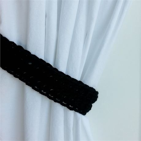 One Pair of Solid Black CURTAIN TIEBACKS - One Pair, 21 long x 2 wide x 1/2 thick   Hand-Crocheted Curtain Tiebacks for use with any kind of curtains or drapes, including shower curtains. I used a very thick 100% acrylic yarn called Hometown USA. The color is called Oakland Black, a basic deep solid black. This yarn is very soft, smooth, and has a slight sheen.   Different monitors/screens can display colors differently, so If an exact match is needed, I can send swatches for the pr...