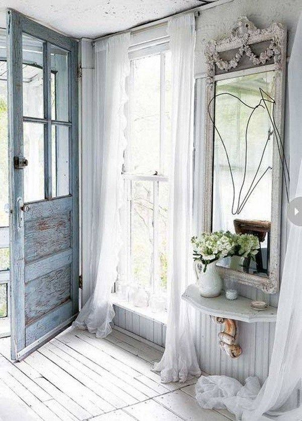 French-style entryway with a serenity aged door.