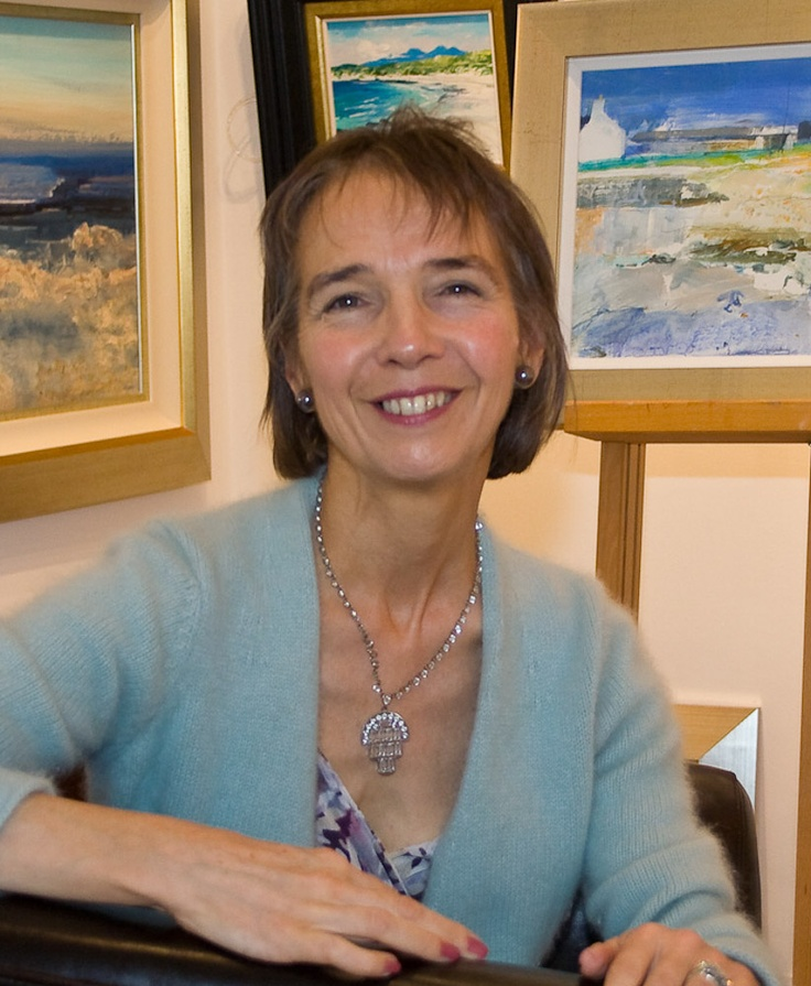 Carolyn Rockwood with some of her paintings