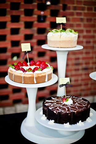 You could go with something like this.  This would be the most cost effective and could pick any type of cakes you want.  This is a different direction, but thought I would put it out there.  This would be $100 plus the cost of renting the stand.