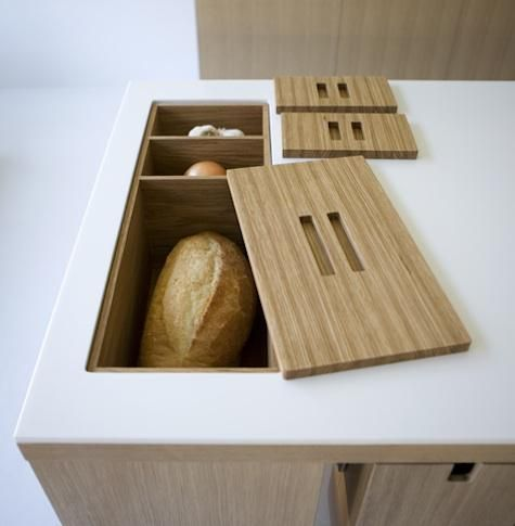 countertop storage for bread, onions, garlics, potatoes.
