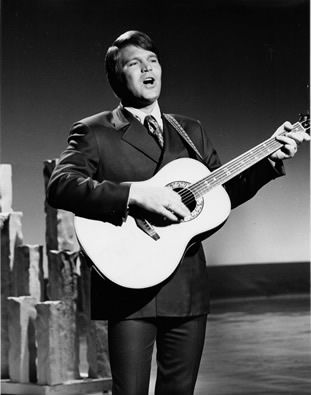 glen campbell single parent personals Glen campbell, the grinning, high  glen campbell, superstar entertainer of 1960s and '70s,  he had a minor hit as a singer with the 1961 pop single turn around.