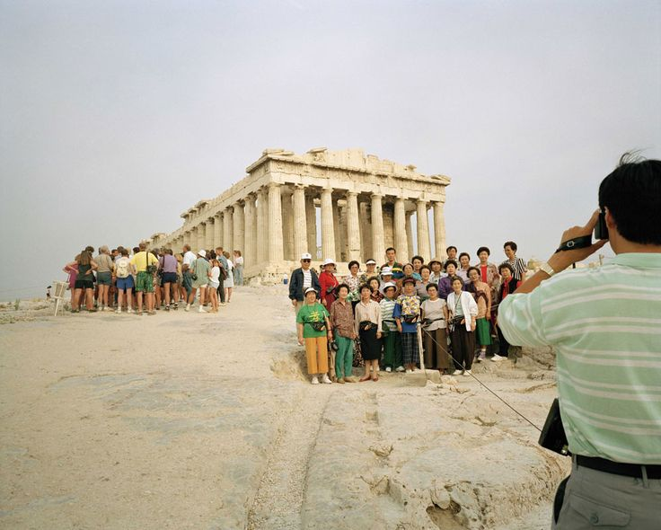 You should see us somewhere in this group of tourists posing for the camera. Or, if not with this one, it is surely the one behind. Or more behind, or even more further. Photo : Martin Parr - Acropolis, Athens, 1991