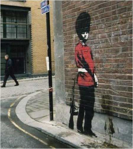 Banksy Pissing Soldier Graffiti - London Pissing Guard (also known as Queen's Guard Pissing) is said to represent how the authorities control the public. The distinctive guards are most often seen at Buckingham Palace and are known for not being able to move while on duty so it is strange to see one in this position – urinating on a street corner.