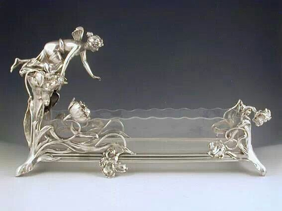 A magnificent Centrepiece with Art Nouveau figural maiden reaching into a pond. Silver and Crystal, Germany 1906
