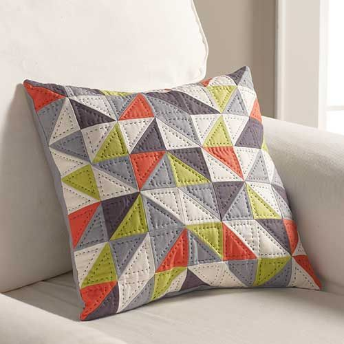 Spinning Arrows Pillow eye catching geometric colors sure to fit with any decor.Make a quilt to match even if it's just a lap quilt.