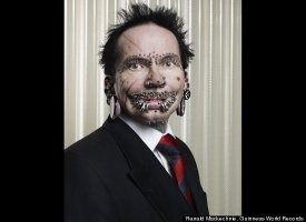 The world's most pierced man, Rolf Buchholz, of Dortmund, Germany, has 453 studs and rings all over his body, including 94 piercings in and around his lips, 25 in his eyebrows, eight in his nose and 278 in his genital area.