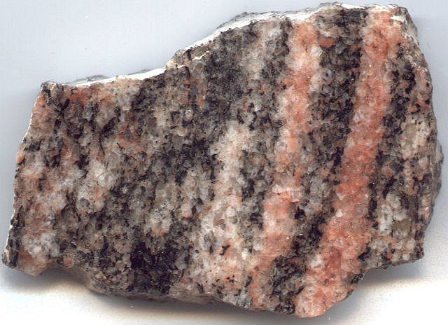Gneiss is a coarse grained, highly metamorphosed,  foliated rock.
