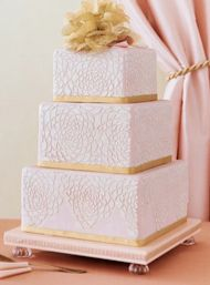 Pale pink and gold square wedding cake