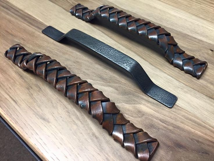 Blacksmith made handles that we're adding to our line of options- Braided flat steel and damascus