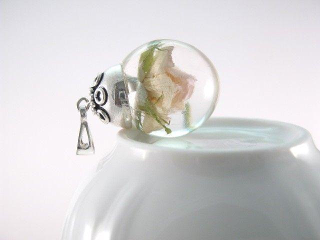 Flower of Rose preserved in resin.   http://en.dawanda.com/product/49527274-Anhaenger---Rose---925-Silber