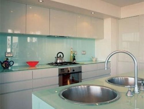 Glass Backsplash with White Cabinets