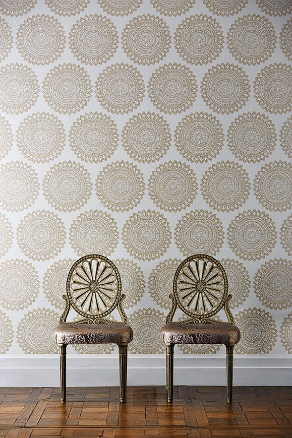 Harlequin's statement Medina wallpaper in neutral and gold from the Leonida collection