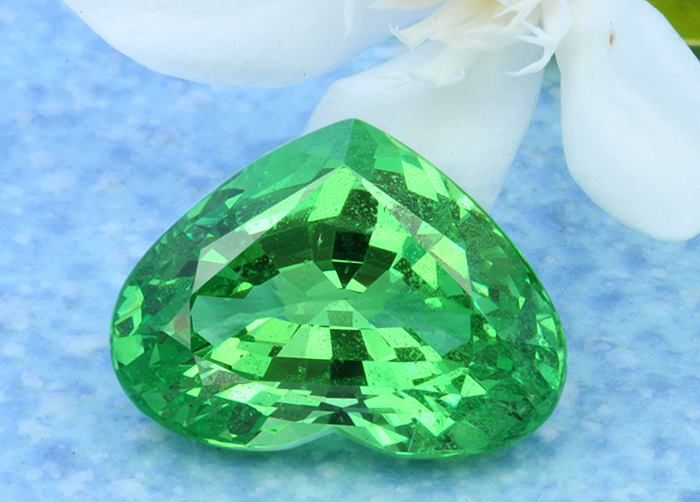 Heart-shaped Tsavorite weighing 8.7 cts which is priced at $2474 per carat.  The difficulties related to the scarcity and procurement of Tsavorite have limited its viability on a commercial scale and it has never been available to mass marketers except in small sizes. Tsavorites are mainly found in Tanzania and Kenya where water for mining is seasonal, roads are in poor repair, fuel costs are high, and access to mining equipment and spare parts is limited.