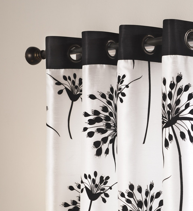 Grommet black and white window panels make any room look modern chic! #AnnasLinens #Curtains #BlackandWhite