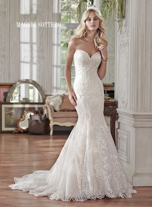 Rosamund wedding dress by Maggie Sottero | Lovely in lace, this fit and flare wedding dress is the epitome of beauty with bold lace appliqués laying atop tulle, cascading to a subtly flared skirt. Finished with sweetheart neckline and corset closure. Detachable lace cap-sleeves sold separately.