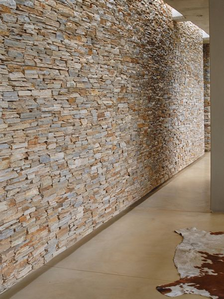 Planning of the home structured around a series of large mass dry-packed stone walls, treated as if almost already pre-existing on the site.