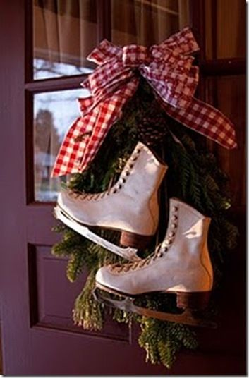 i like it: the burgandy door, the greenery, the ice skates and the red gingham ribbon. thank you, j