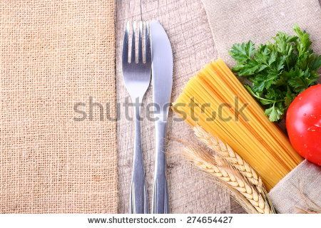 seasonal wooden table with pasta and cutlery