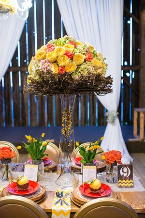 Lavish Dulhan South Asian bridal magazine photo shoot at Cambium Farms; tall vase wedding centrepiece with yellow & pink roses and twigs.