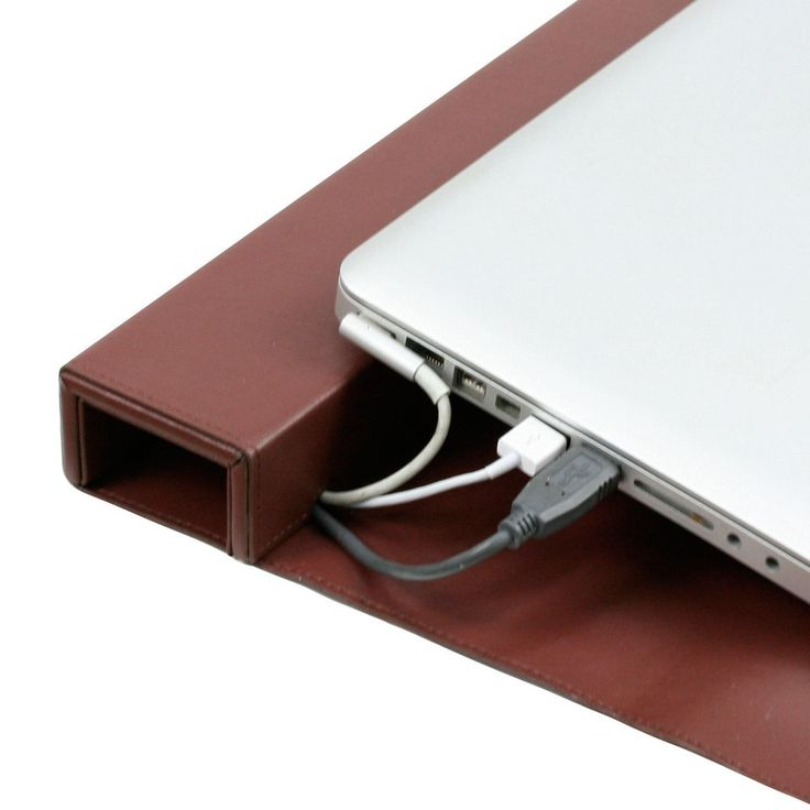 GreatUsefulStuff - Laptop Lift Mat and Cord Concealer, $29.99 (http://www.greatusefulstuff.com/tech-storage-and-organization/charging-stations/laptop-lift-mat-and-cord-concealer/)