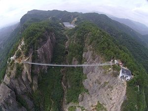 Glass bottom suspension bridge in China. 180 metres of awesome.