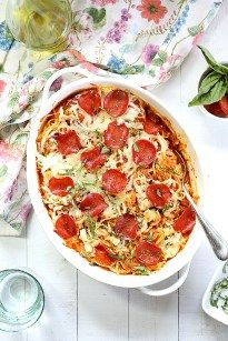 4-Ingredient baked spaghetti squash pizza casserole topped with turkey pepperoni is almost the easiest low-carb & one-dish dinner you will love! Roast spaghetti squash ahead of time for a delicious quick dinner in 30 minutes or less! In a bowl add roasted spaghetti squash & marinara sauce and mix the spaghetti