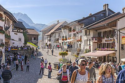 The main street and tourists at the Castle at Gruyere, Switzerland .  http://www.chateau-gruyeres.ch/
