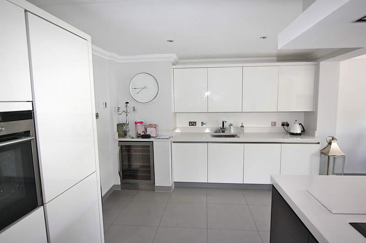 Handleless kitchens from LWK Kitchens - High gloss white handleless kitchen acrylic - Discover more at www.lwk-home.com