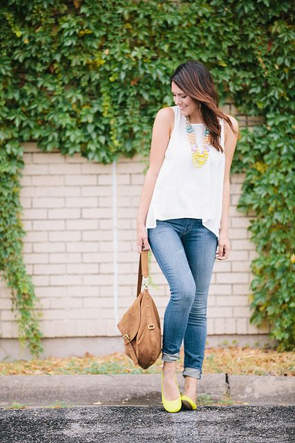 Cute top + statement necklace + jeans + yellow shoes (pop of color!) + light brown messenger bag