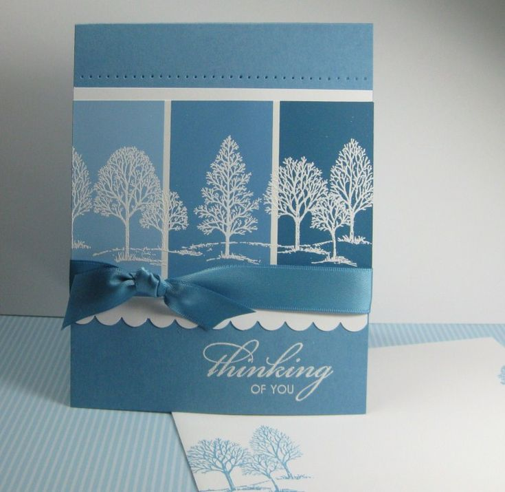 paintchip card in blues with with white stamping...luv the white trees against the blue...lovely as a tree