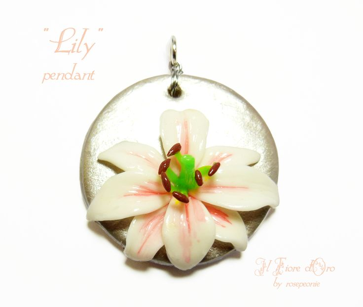 """Lily"", pendant representing a white and pink lily in high-relief on a silver background.  The lily is a symbol of purity, nobility and dignity of spirit - a flower worthy of a queen. This pendant, made entirely by hand from molding to painting, it's then not only an original, elegant jewel, but..."