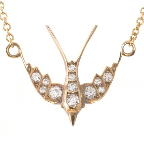 An 18ct oxidised yellow gold diamond swallow pendant made by Single Stone LA. View our collection of antique, Art Deco, and modern jewellery at www.rutherford.com.au
