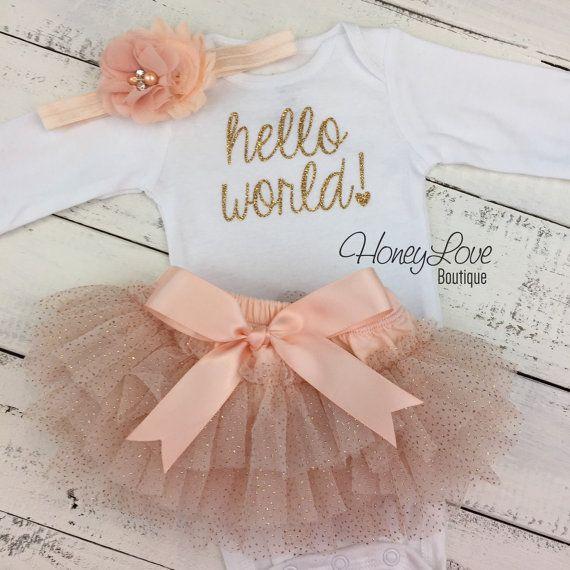 hello world! gold shirt bodysuit, peach glitter ruffle tutu skirt bloomers, flower headband bow, newborn baby girl take home hospital outfit by HoneyLoveBoutique