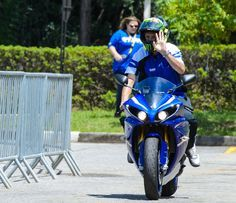 Multiple world champion Valentino Rossi traveled to Brazil with Yamaha for some official business, but it was not a MotoGP-related trip. Neither was he there for samba lessons, despite some of the pictures after the jump may indicate so. Rossi and the Brazilian girls were there to promote a new 125cc bike for the South American market.
