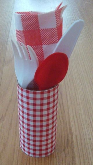 Utensils Holder - Rather than throwing all the napkins and utensils into their own respective holders, make it a bit more decorative by making a place setting for each person.