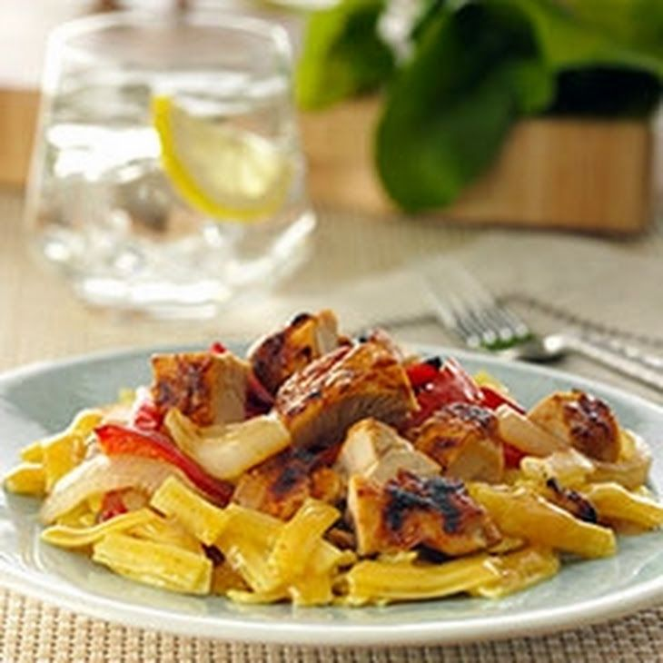 Indian-style Tandoori Chicken and Noodles Recipe with boneless chicken skinless thigh, olive oil, chili powder, nonfat plain greek yogurt, lemon juice, cumin, onion, red bell pepper, knorr pasta side   chicken